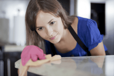 Can I Charge by the Hour for House Cleaning, Woman Cleaning Counter