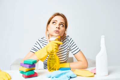 Can I Charge by the Hour for House Cleaning, Woman Thinking with Cleaning Supplies