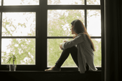 Depressed and Can't Cope with Cleaning, Woman Sitting in Window
