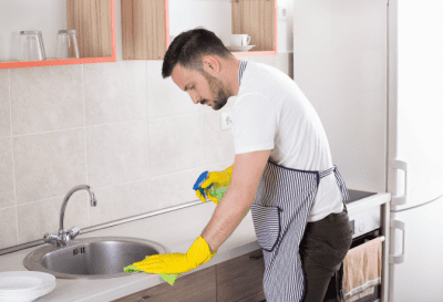 Sending Teams Back Out, Man Cleaning Counter