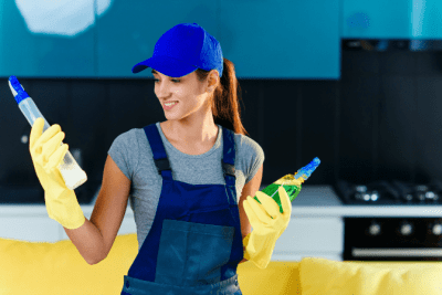 Sending Teams Back Out, Woman Reading Back of Cleaning Bottle