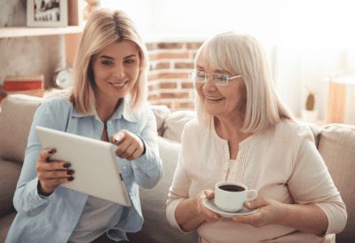 What I Learned from Doing 900 Cleaning Videos, Two Women Looking at Tablet