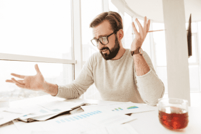 Start a Cleaning Company in Another Country, Confused Man Looking at Paperwork