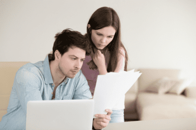 Start a Cleaning Company in Another Country, Man and Woman on Computer Looking at Papers