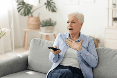 What Do You Want, Surprised Woman Holding Remote Watching TV