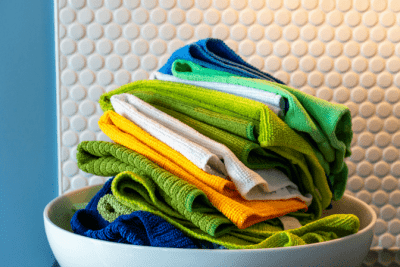 Cleaning Cloths - Who Provides Them, Pile of Cleaning Cloths in Bowl