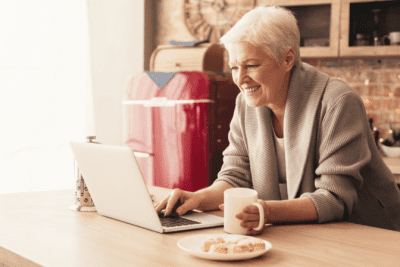 How to Get Cleaning Clients Online, Woman Looks at Computer