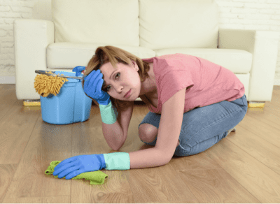 Should You Tell Employees You're New, Overwhelmed Woman Cleaning