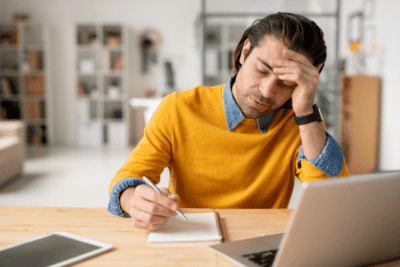 The Secret Behind Checklists, Man Thinking While Writing in Notepad