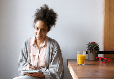 The Secret Behind Checklists, Woman Writing on Notepad
