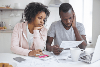 Are You Winging It With Your Money, Worried Couple Paying Bills