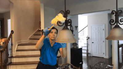 Wash and Recycle a Swiffer Duster, Angela Brown Using Swiffer Duster on Lights