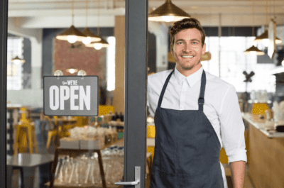 From Restaurant to Cleaning, Cafe Manager With Open Sign on Door