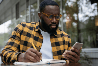 From Restaurant to Cleaning, Man Looks at Phone