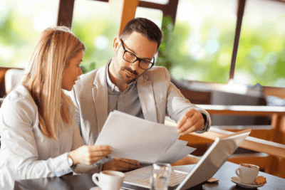 From Restaurant to Cleaning, Man and Woman Look at Papers
