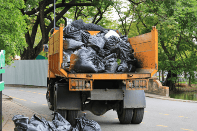 Hoarding Cleanup A New Way to Help, Trash on Truck