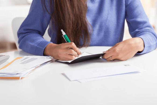 Becoming a Boss, Woman Writing Check