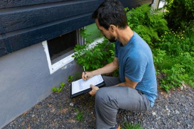 Mold and Mildew, Man Examines Crawl Space