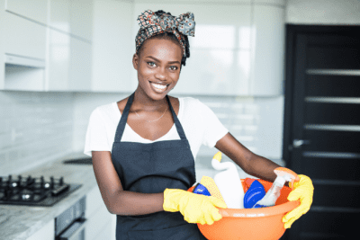 Sloppy House Cleaner, Woman Holding a Cleaning Caddy