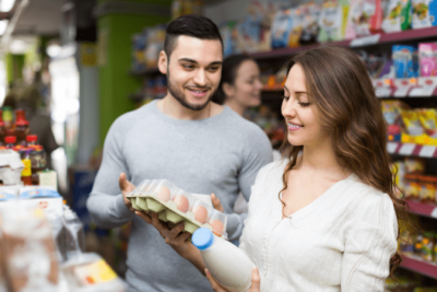 Notice to Raise Rates, Couple Buying Milk and Eggs