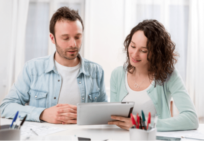 Business Partner Meetings, Couple Looking at Tablet
