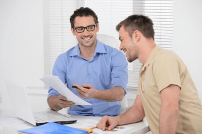 Business Partner Meetings, Men Looking at Document