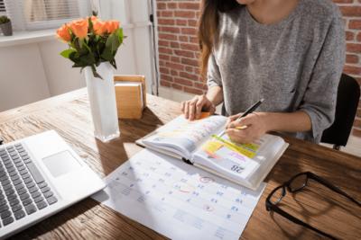 Business Partner Meetings, Woman Looks at Calendar