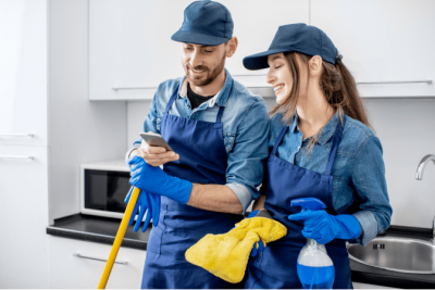 No Such Thing, House Cleaners Look at Phone