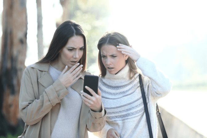 Local Cleaning Company, Upset Women Look at Phone