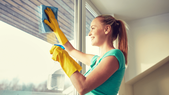 Move Out Cleans Only, Woman Cleaning Windows