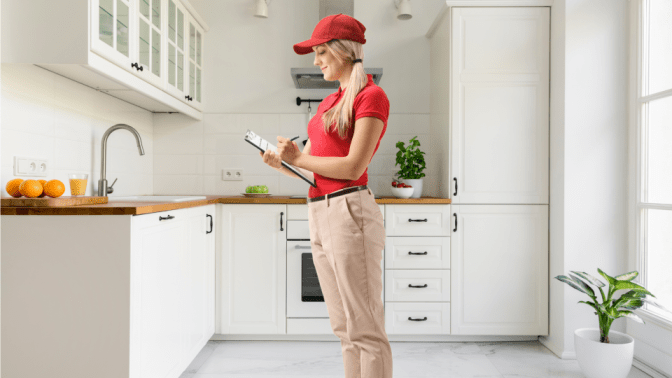 World's Greatest Cancellation Policy, Woman With Clipboard in Kitchen