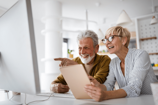 Explode Your Cleaning Business, Happy Couple on Computer