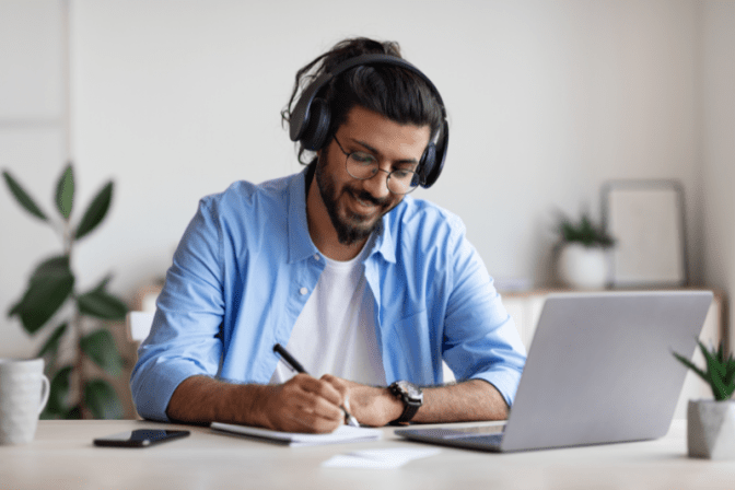 Explode Your Cleaning Business, Man With Headphones on Computer