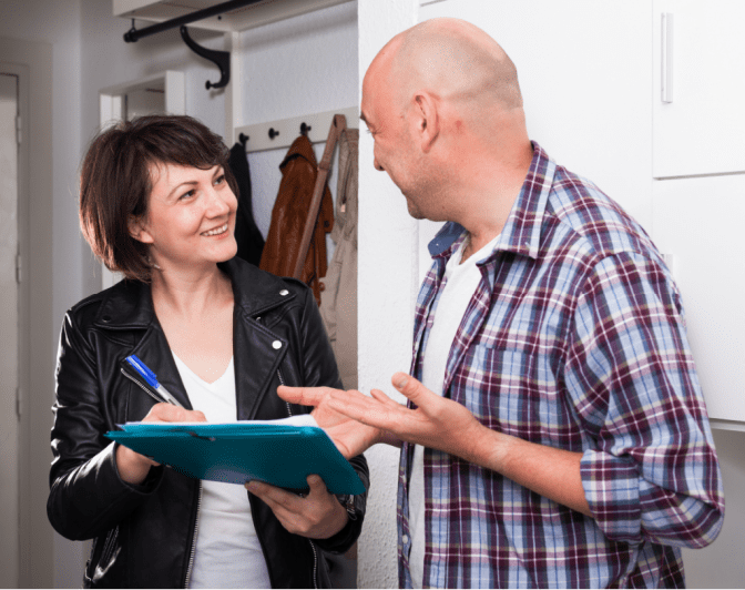Explode Your Cleaning Business, Woman with Clipboard Talking to Man
