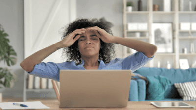 Brick and Mortar, Frustrated Woman on Computer
