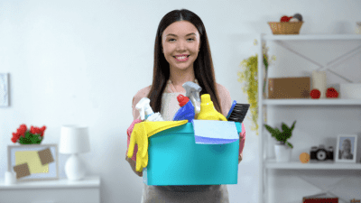 Brick and Mortar, Woman Holding Cleaning Supplies